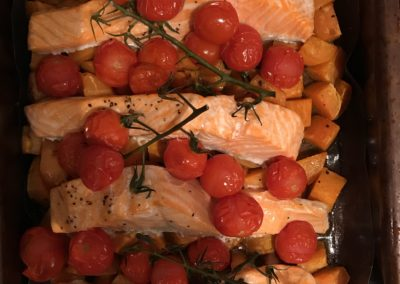 Roasted salmon with sweet potatoes & tomatoes