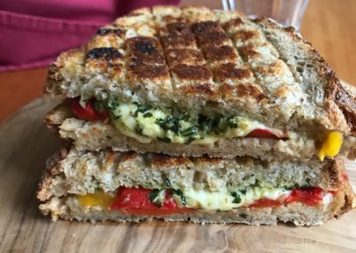 Grilled mozarella, pesto & roasted pepper sandwich